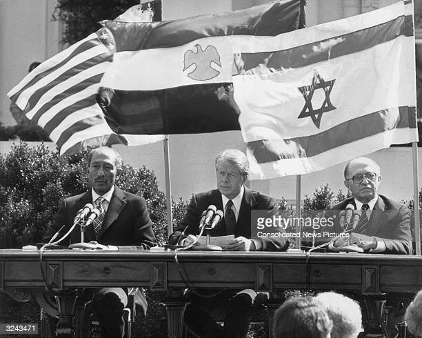LR Egyptian president Anwar alSadat United States president Jimmy Carter and Israeli prime minister Menachem Begin preparing to sign the Egypt Israel...