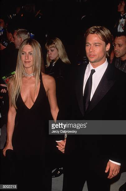 Engaged American actors Jennifer Aniston and Brad Pitt hold hands at the 'Vanity Fair' Oscar Party Morton's restaurant Beverly Hills California...