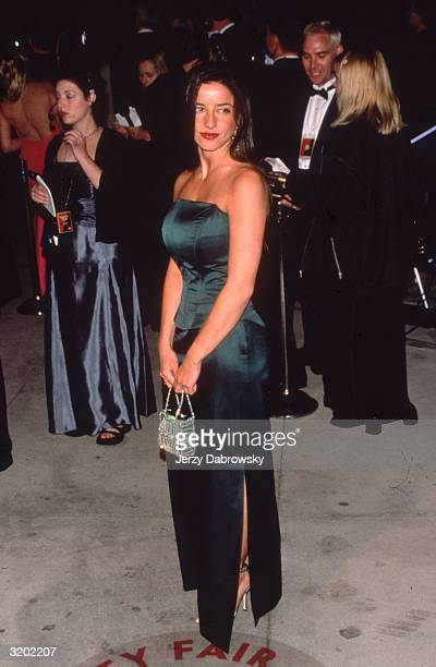 Fulllength image of American lingerie designer Shoshanna Lonstein former girlfriend of comedian Jerry Seinfeld posing in a strapless green corset top...