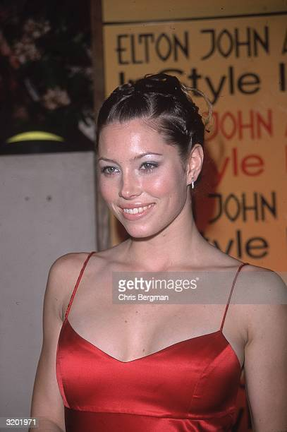 Headshot of American actor Jessica Biel smiling in a red dress with spaghetti straps at the Elton John/'In Style' Oscar Night party, Beverly Hills,...