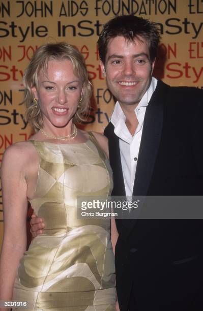 Headshot of American actors Jenny McShane and Bentley Mitchum embrace at the Elton John/'In Style' Oscar Night party Beverly Hills California