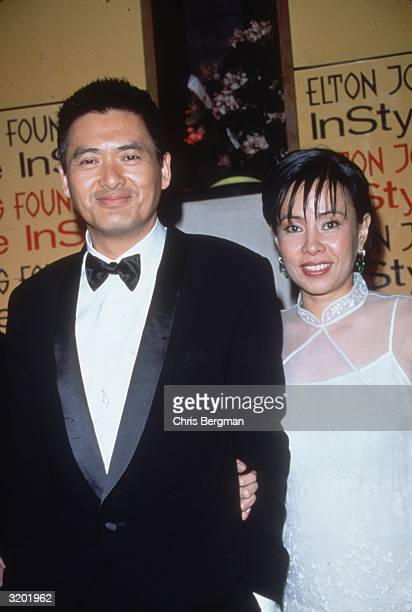 Hong Kongborn Chinese actor Chow YunFat and his wife Jasmine pose together at the Elton John/'In Style' Oscar Night party Beverly Hills California He...