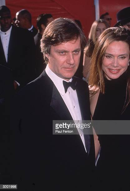 Swedish director Lasse Hallstrom and his wife Swedish actor Lena Olin at the Academy Awards Shrine Auditorium Los Angeles California Hallstrom was...