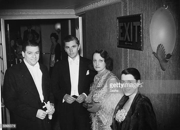 Librettist and songwriter Oscar Hammerstein II left and Canadian revue star Beatrice Lillie right attending the opening night of 'Wild December' at...