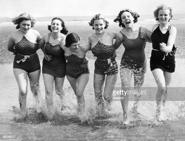 Women enjoying their first dip of the season at Porthcawl South Wales during Whitsun