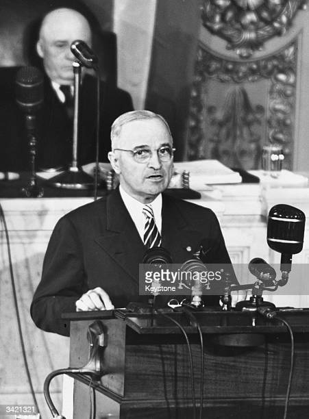American President Harry S Truman addressing a joint session of congress in Washington DC Seated behind the president is Sam Rayburn the speaker of...