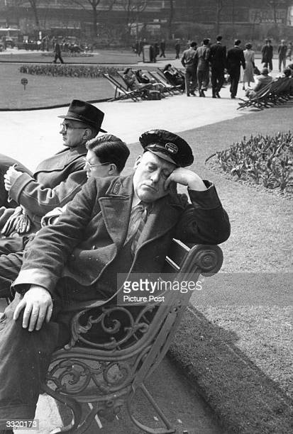 City of Westminster employee relaxes in the sun during his lunchbreak on the Embankment, London. Original Publication: Picture Post - 5309 - All...