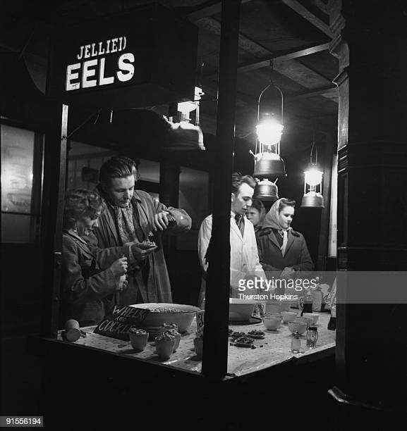 Customers at a jellied eel stall Many such stalls used to pepper the streets of London Original Publication Picture Post 5309 All London pub 1951