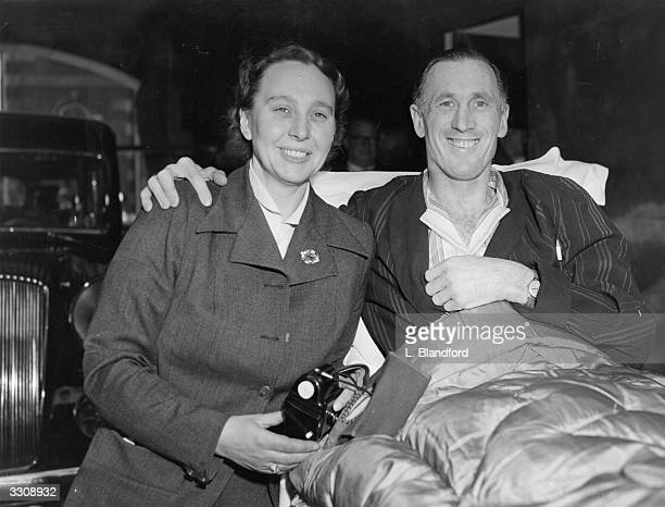 Arsenal FC captain Joe Mercer with his wife at the entrance to the Royal Northern Hospital suffering from a broken leg