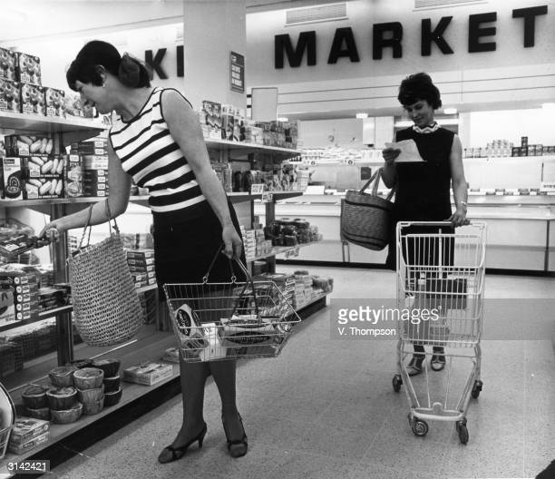 Shoppers with wire baskets and shopping trolleys in the new modern Key Market supermarket at Hockley in Essex.