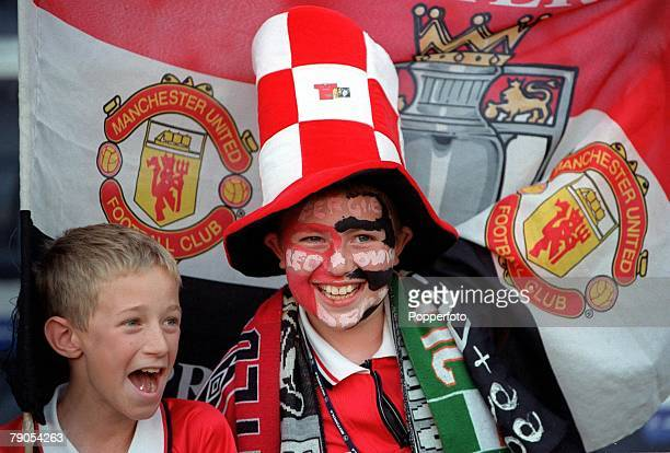 26th MAY 1999 UEFA Champions League Final Barcelona Spain Manchester United 2 v Bayern Munich 1 Two young Manchester United fans watch the match one...