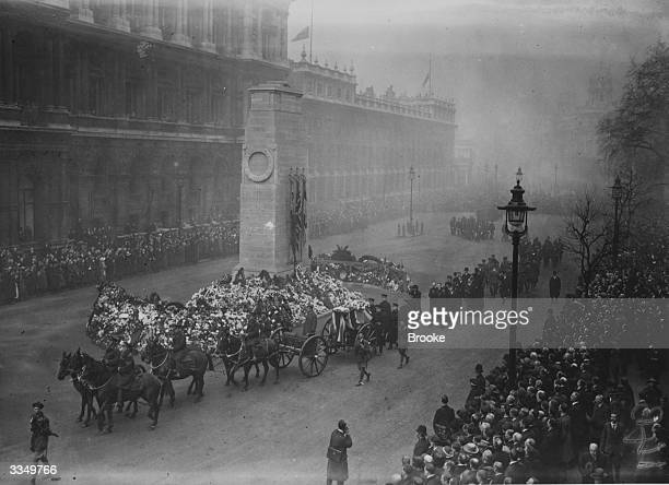 The funeral of British officers killed in Ireland passes the Cenotaph in London.