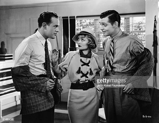 Constance Bennett tries to prevent an altercation between Clark Gable and Harvey Stephens in 'After Office Hours' directed by Robert Z Leonard