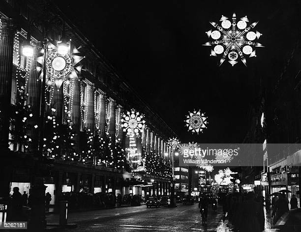 The overhead decorations in Oxford Street London at the Marble Arch end near to Selfridges are gleaming out into the night and creating a...