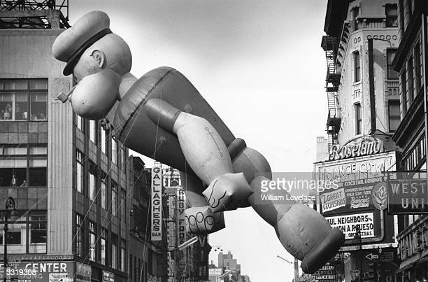 An inflated Popeye floats above the Thanksgiving Day Parade in New York as it nears Times Square