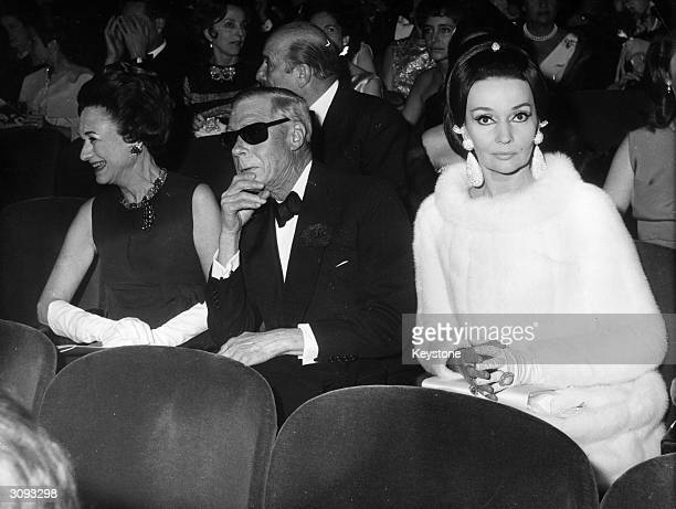 From l to r the Duchess of Windsor the Duke of Windsor and ballerina Ludmilla Tcherina at a gala in the Alhambra Paris to celebrate the 20th...