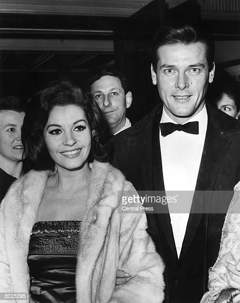 Roger Moore of the television series 'The Saint' at a London film premiere with his fiancee Luisa Mattioli