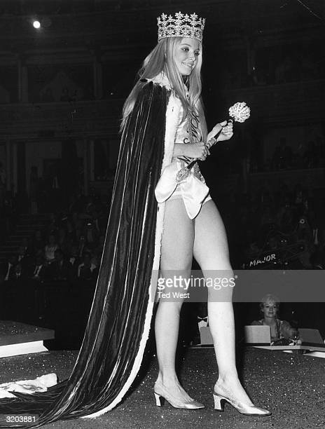 Eva ReuberStaier Miss Austria navigates the catwalk in front of a panel of judges and audience members after being crowned Miss World 1969 at the...
