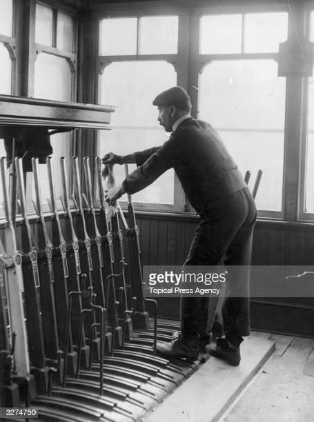 A signalman operating a signal