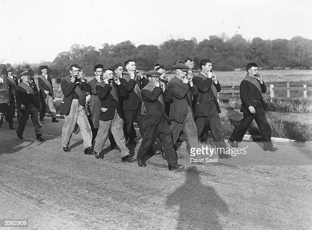 Group of harmonica players provide a band for the unemployed hunger strikers as the historic Jarrow March passes through the village of Lavenden on...