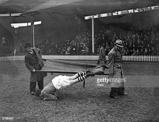 Little light relief from the Crazy Gang during the 9th annual football match between England's leading jockeys and boxers. Boxer Dave Crowley gets...