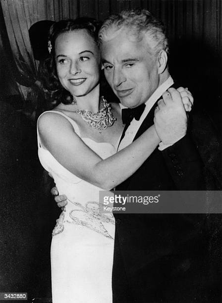 Charlie Chaplin with his wife the actress Paulette Goddard at Broadway New York