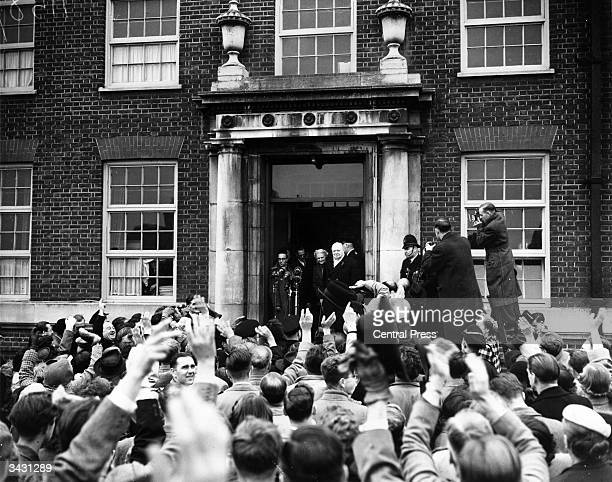 Winston Churchill speaking to cowds gathered outside St Barnabas School in Woodford after the constituency had voted him their Member of Parliament