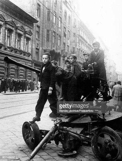 26th October 1956 Budapest Hungary Hungarian Uprising Children play in the street on an abandoned gun as the Communist uprising takes place