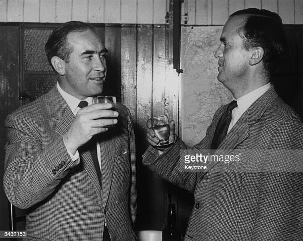 Ipswich Town Football Club Manager Alf Ramsey is congratulated by his club chairman John Cobbold upon his appointment as manager of the England team...