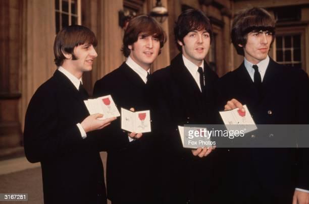 British pop group The Beatles, from left to right; Ringo Starr, John Lennon , Paul McCartney and George Harrison , outside Buckingham Palace, London,...