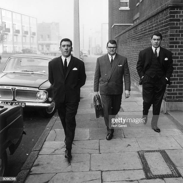Notorious East End gangsters Ronnie and Reggie Kray on their way to the Thames Street court in London