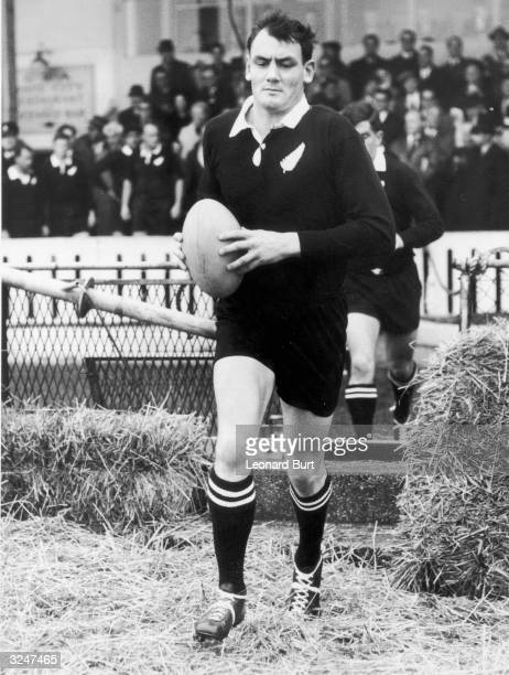 Brian Lochore captain of the New Zealand All Blacks leading his team out