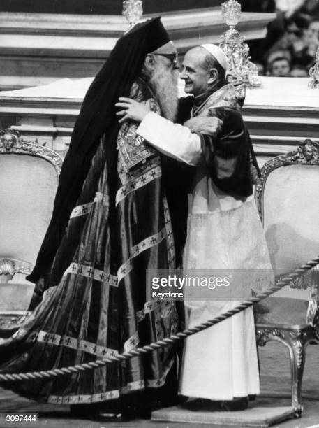 Pope Paul VI and Patriarch Athenagoras the supreme leader of Eastern Orthodoxy embracing during a ceremony at the St Peter Basilica