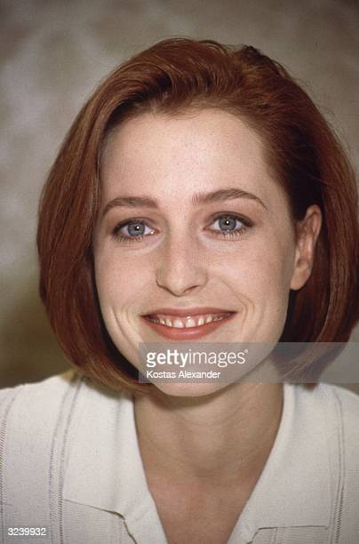 Headshot of American actor Gillian Anderson smiling on the set of the television series 'The XFiles' Vancouver British Columbia