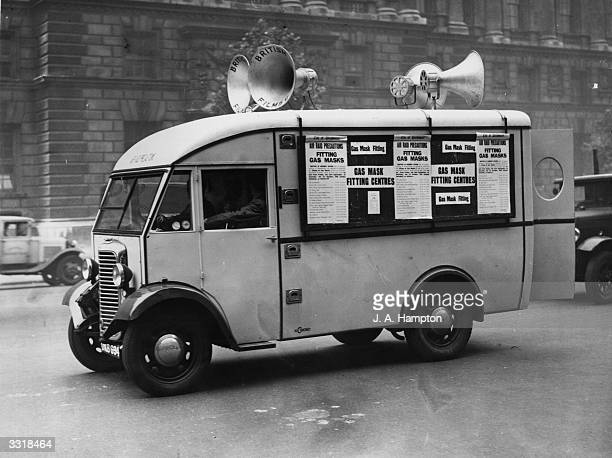 A van advertising the necessity for people to be fitted for gasmasks touring around Whitehall London
