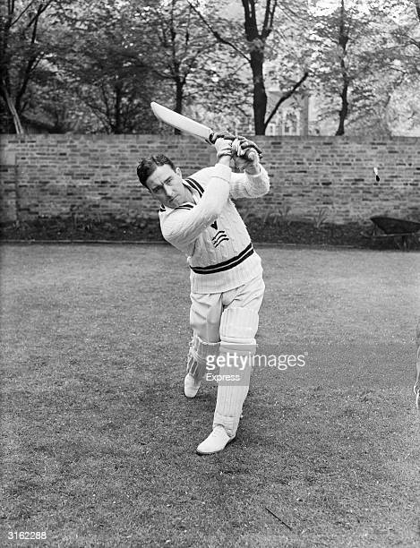 British footballer and cricketing champion Denis Compton demonstrates his winning moves