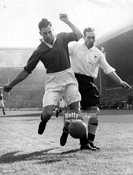 Alf Ramsey of Tottenham Hotspur tussles for the ball with Jack Rowley of Manchester United during their match at White Hart Lane