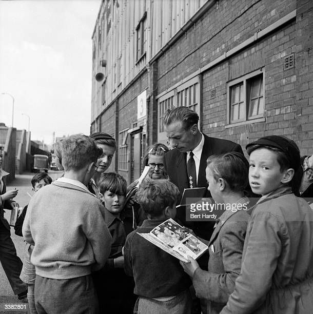 Blackpool Football Club player and household name Stanley Matthews signs autographs for young fans outside Blackpool's ground After all these years...