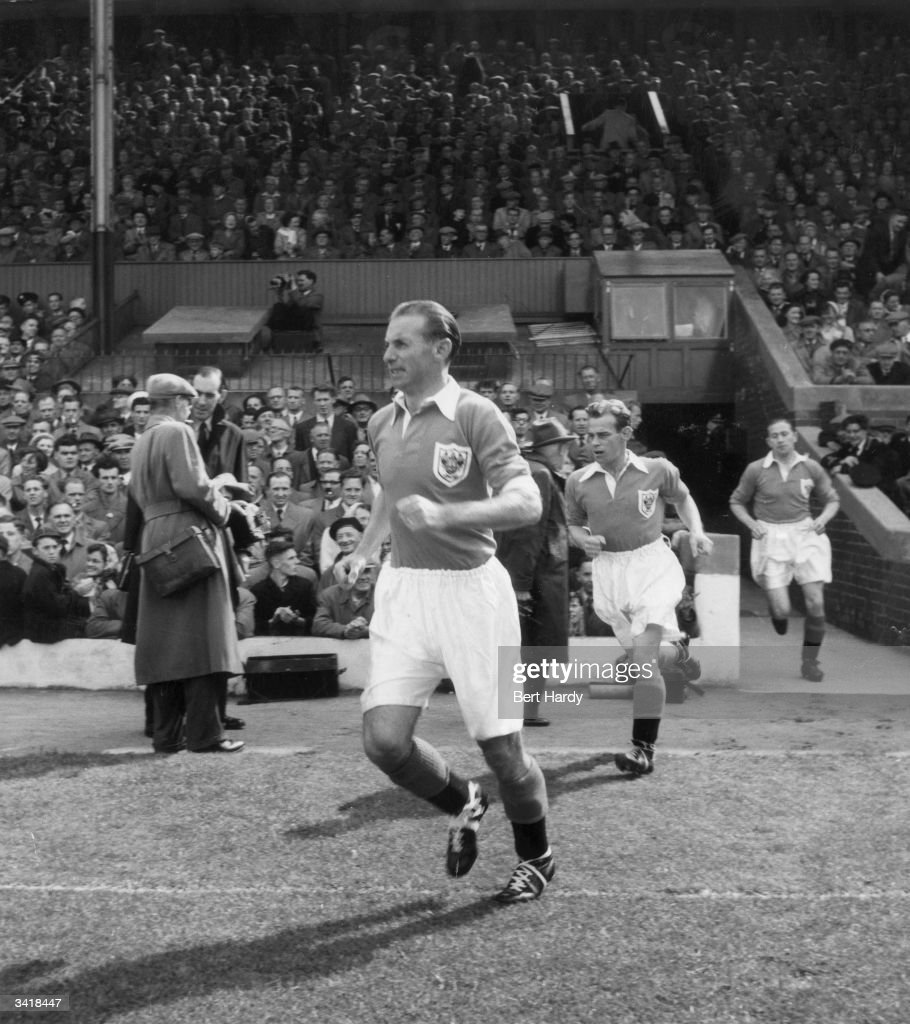 Britain's most famous football player, Stanley Matthews, takes to the pitch for Blackpool FC in a match against Chelsea FC at Bloomfield Road. Original Publication: Picture Post - 6721 - Stanley Matthews, The Hero At Home - pub. 1953