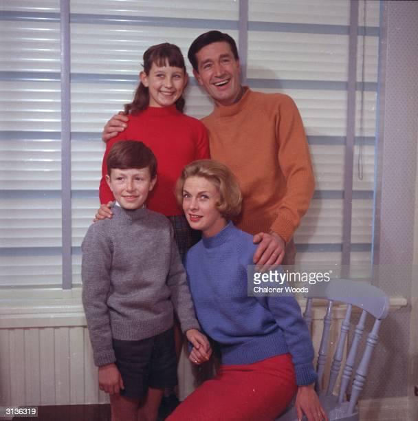 Family group wearing plain, stocking stitch sweaters. Bestway knitwear.
