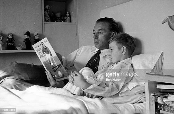 Footballer Stanley Matthews reads a football manual with his son Stanley Jnr at bedtime Original Publication Picture Post 6721 Stanley Matthews The...