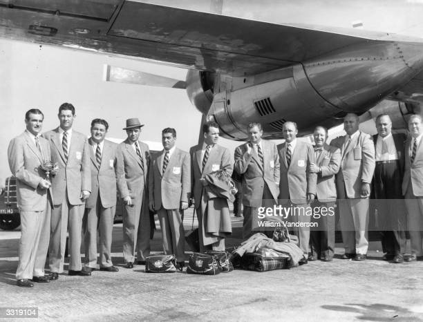 Members of the American Ryder Cup team at London Airport Left to right Lloyd Mangrum the Captain Gary Middlecoff Ed Oliver Sam Snead Jim Turness Jack...