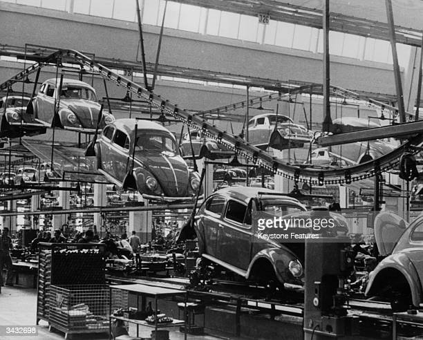 A production line manufacturing Volkswagen beetles at the factory in Wolfsburg West Germany