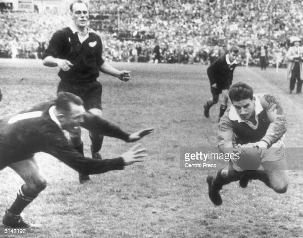 British Lions' fly half Bev Risman scores in the rugby final test match against New Zealand in Auckland D B Clarke leaves the tackle too late
