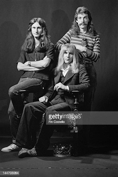 Canadian progressive rock group Rush pose for a group studio portrait in Bakersfield California USA on 26th September 1977 Left to right bassist...