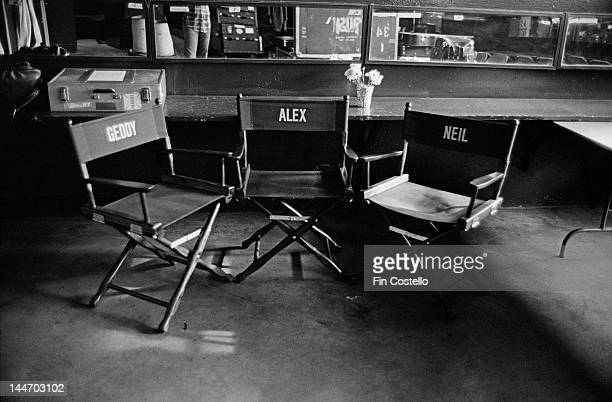 Directors chairs with the names of Geddy Lee Alex Lifeson and Neil Peart from Canadian progressive rock band Rush printed on canvas backs in the...