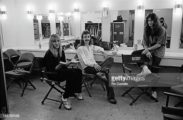 Guitarist Alex Lifeson drummer Neil Peart and bassist Geddy Lee from Canadian progressive rock band Rush pose backstage at the Civic Auditorium...