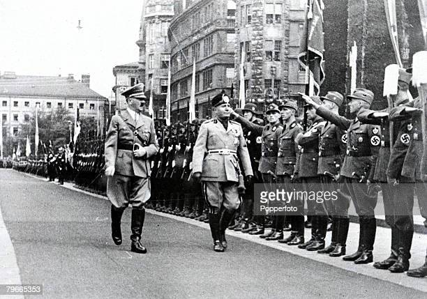 26th September Nazi leader Adolf Hitler accompanied by Italian fascist dictator Benito Mussolini as they are given the Nazi salute by German soldiers
