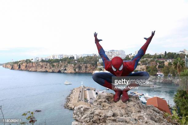 """Year-old Burak Soylu with his Spider-Man costume performs in Antalya, Turkey on November 4, 2019. Burak Soylu, who has worked at hotels as """"super..."""