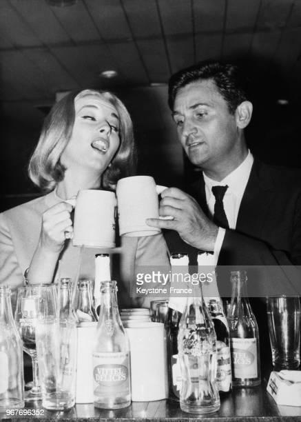Between shots Roger Hanin and Italian actress Daniela Bianchi at the airport bar